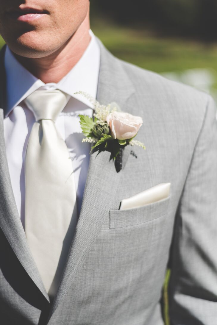Kolton had a single blush rose pinned to his light gray jacket, which he wore with his ivory tie and pocket square.