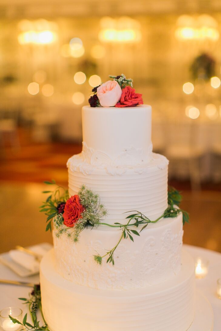 Small pink and red roses decorated the three tier white cake by Cake Sweet Food Chicago.