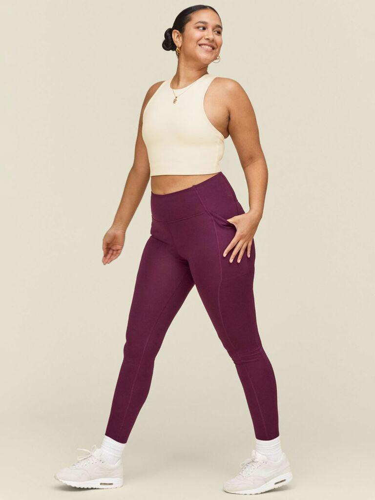 person wearing purple workout leggings