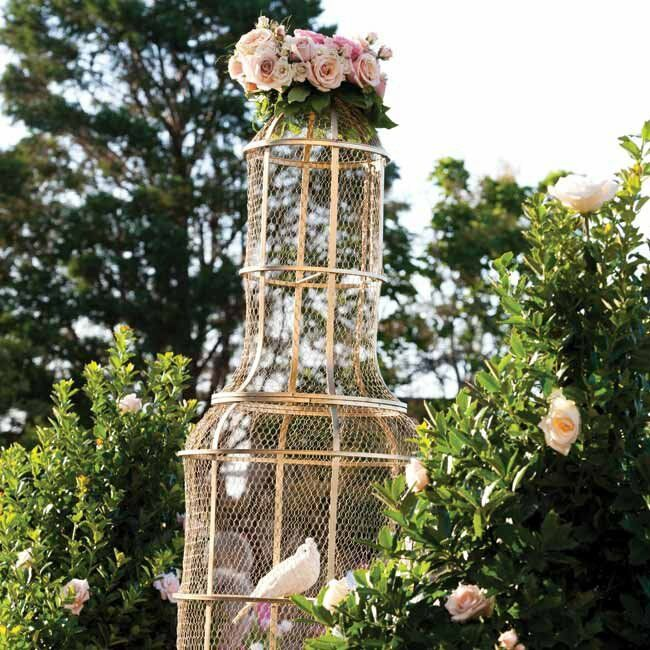 Evoking the extravagant visuals from the favorite movie, live white doves were placed around the property in gold cages.