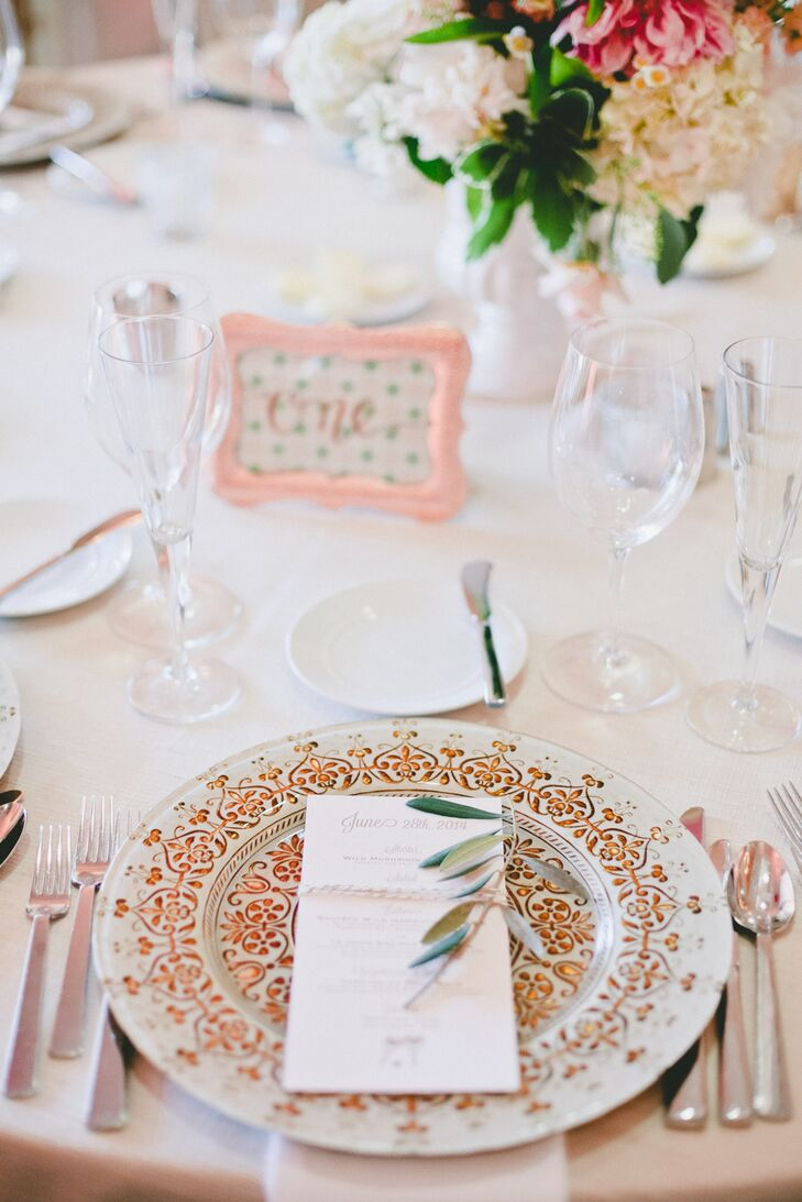 Decorated with an intricate gold design, the dinnerware tied into the evening's rose gold theme, will taking the tablescapes to glam new heights. Each plate was adorned with olive leaves for a touch of rustic flair.