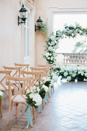 Elegant Ceremony with White Flower Arch and Aisle Decorations