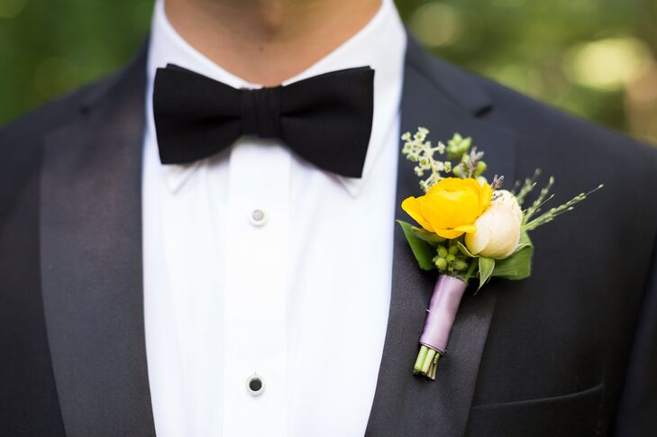 A yellow and cream rose were tied together with a lavender ribbon for the boutonniere.