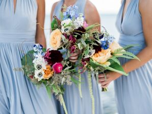 Pale Blue Bridesmaid Dresses and Tropical Bouquets