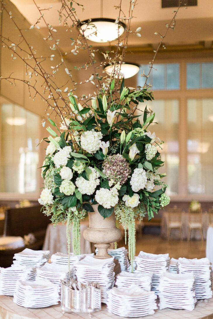 A simple color palette of ivory and green lent a traditional feel to Abbi and Cameron's elegant affair.