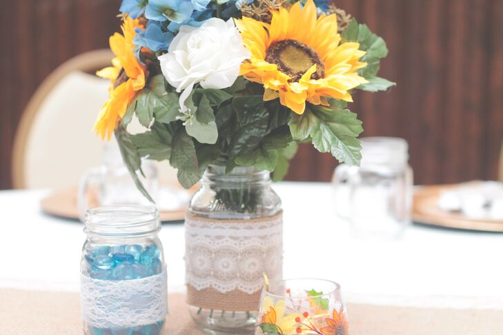 Mason jars with burlap and lace were the perfect way to style the country wedding.