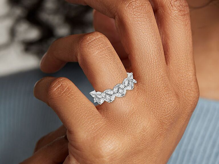 Close-up of diamond and platinum ring on woman's hand