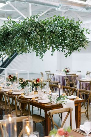 Farm Tables With Hanging Greenery Chandeliers at The Madison in Cleveland, Ohio