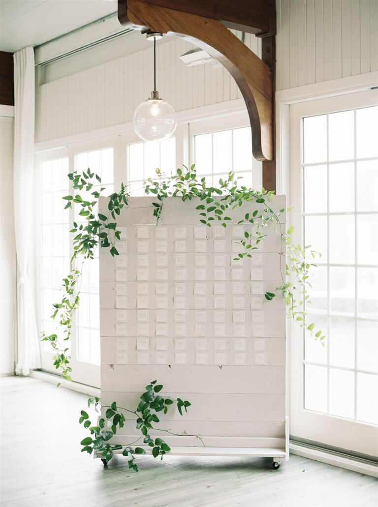 White seating chart with greenery accents