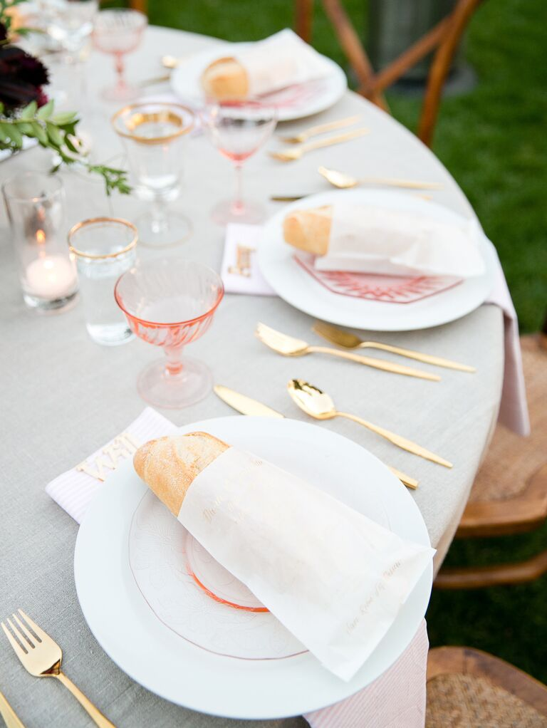 Pink And Gold Place Settings At Outdoor Wedding Reception