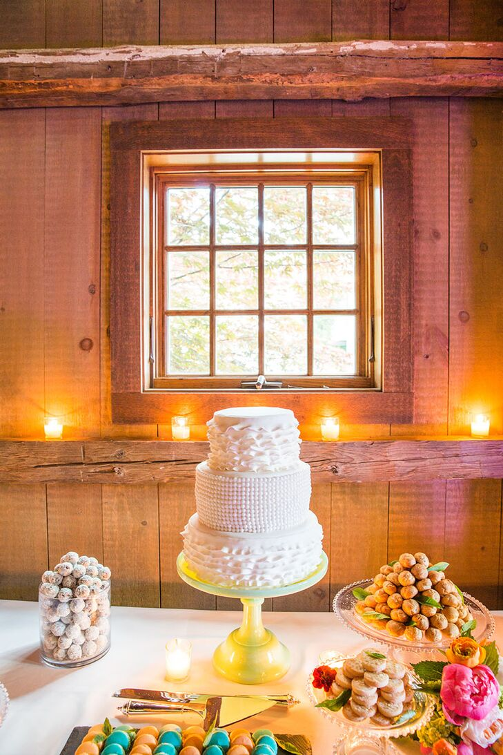 Dessert Table With Wedding Cake And Macarons In Barn