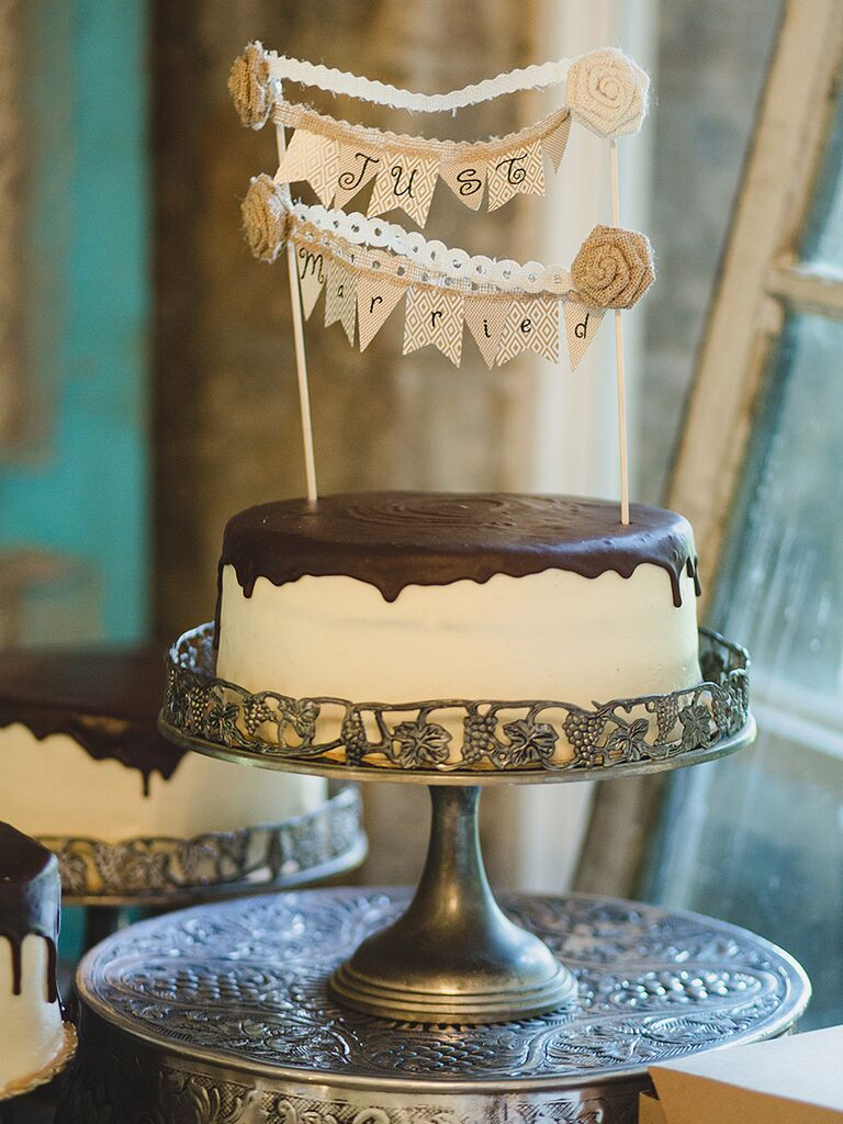 Drip wedding cake design with a chocolate peanut butter flavor