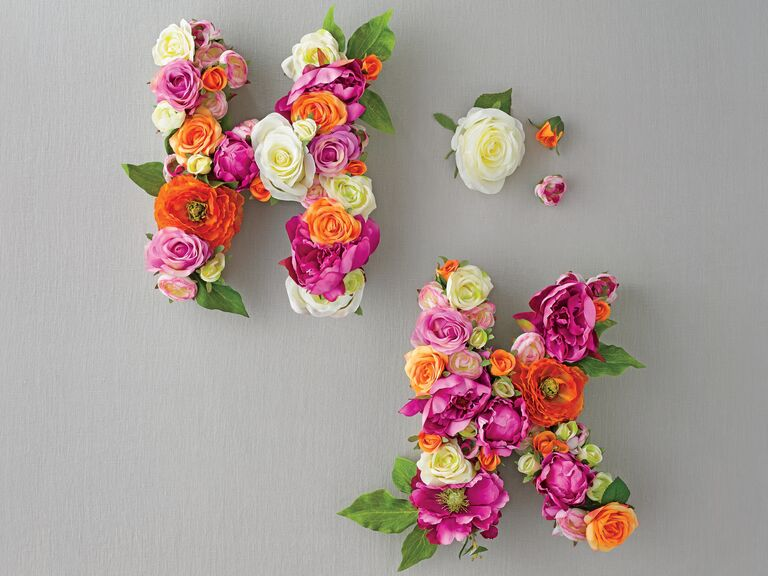 Youll want to keep this silk flower diy long after the wedding initial monograms with silk flowers and cardboard letters solutioingenieria