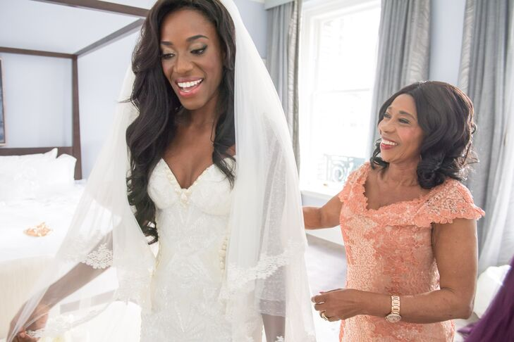 Beth looked to Old Hollywood for her wedding day looks, including glamorous long curls she kept throughout her outfit changes and a romantic bouquet of blooms.