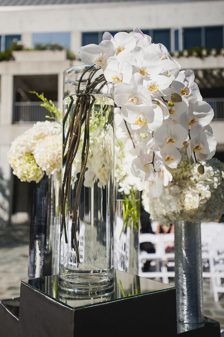 White orchids and hydrangeas added a contemporary and chic touch to the ceremony.