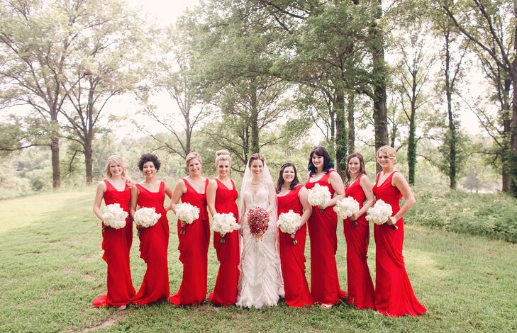With eight bridesmaids in all shapes and sizes, it was important to Nicole to find a  dress style that flattered everyone. After looking at two boutiques in New York, the maid of honor discovered the perfect dress at David's Bridal. The bridesmaids carried white bouquets of hydrangeas, dahlias and roses.