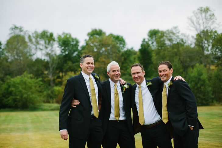 The groomsmen wore navy suits with gold ties.