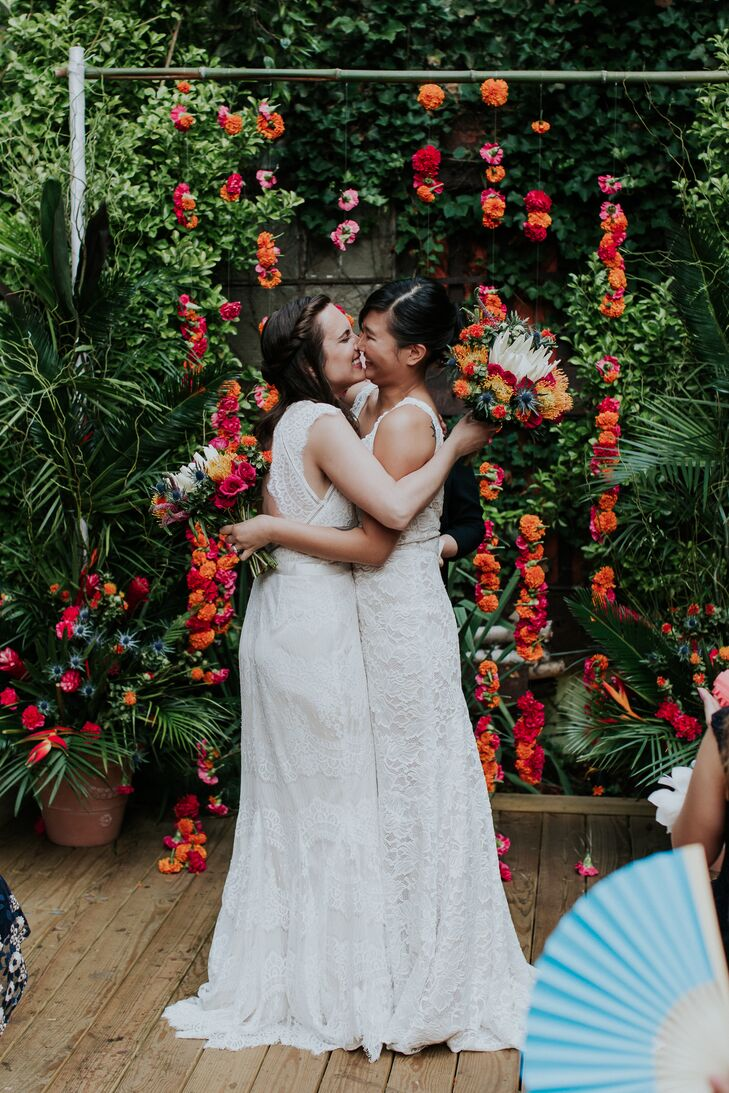 Lesley	Brown and Areum Kim's modern, colorful Brooklyn wedding ceremony took place in an outdoor space filled with greenery. The brides complemented e
