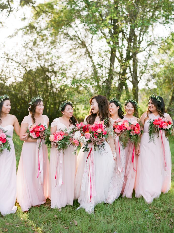 """""""I asked my six bridesmaids to choose their own blush/light pink dress in whatever style they felt comfortable, while my maid of honor had a floral design,"""" Deborah says. """"I really wanted their personalities to shine through with me on the wedding day. Their beautiful dresses tied in together and created a perfect mix and match."""""""
