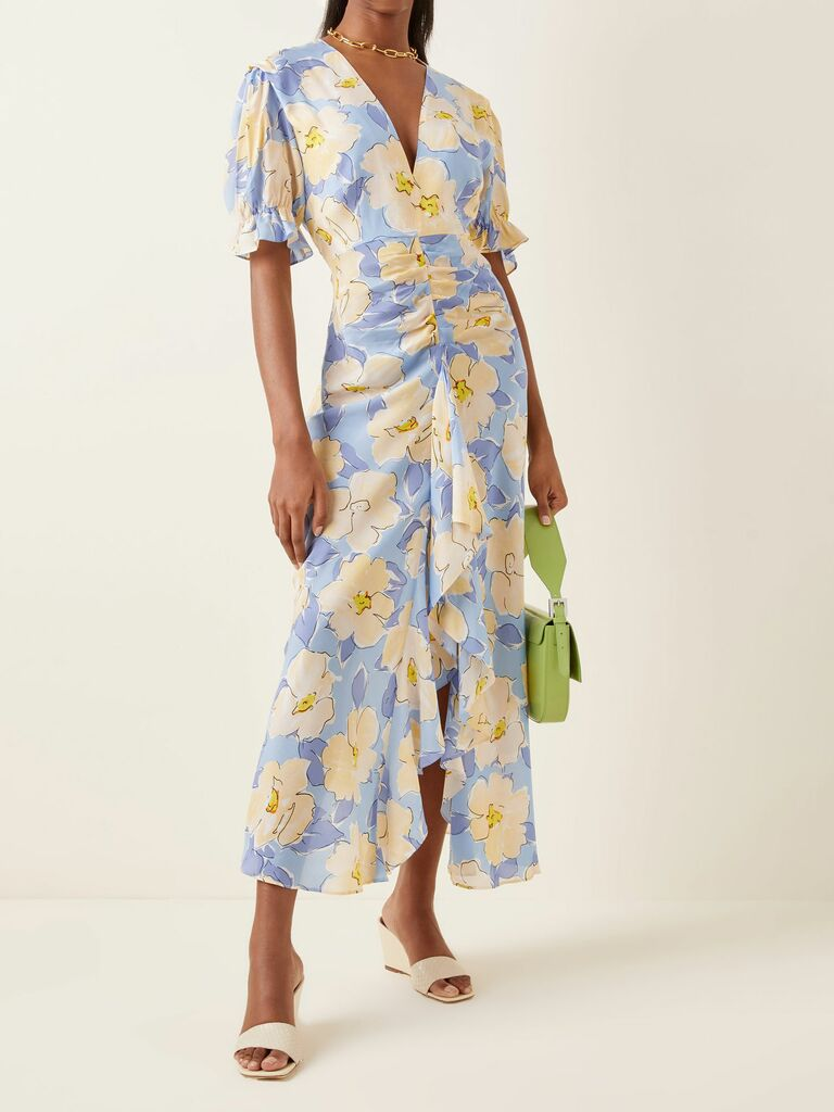 blue floral dress with gathered waist and ruffle skirt
