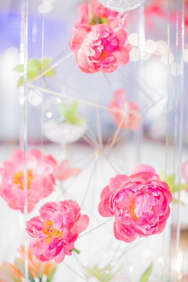 """Monica gave her florist a vague vision, and the result was stunning. """"My favorite part of the flowers was definitely the ceiling piece above the dance floor,"""" Monica says of the decor at the Joule in Dallas, Texas."""