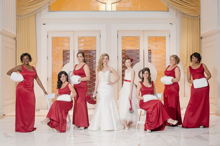 """The dresses tied in the holiday theme without being too flashy,"" Francesca says of the floor-length red bridesmaid dresses."