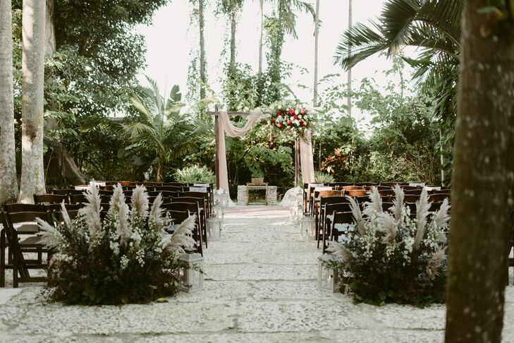 Tropical Ceremony with Wedding Arch and Aisle Decorations