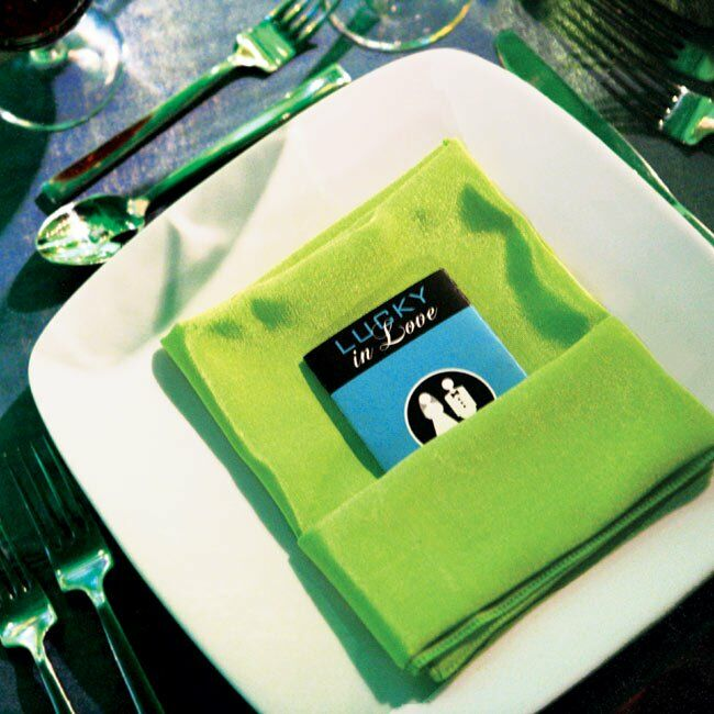 Green dinnerware and napkins shined atop all-white square plates and black linens.