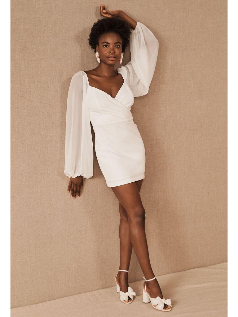 White mini dress with long sheet blouson sleeves