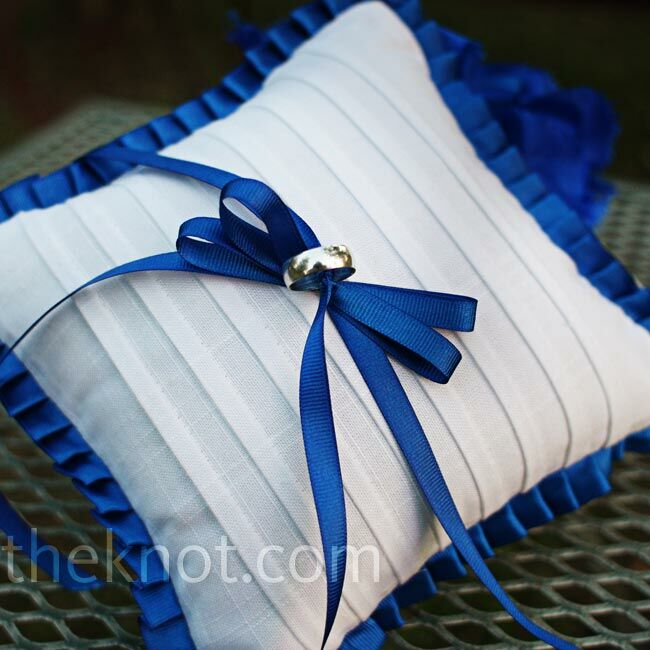 Lindsey's mom hand-sewed a blue-and-white pillow to hold the rings.