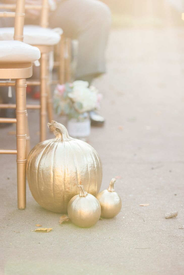 To play up their autumnal wedding date, the pair had mini gold pumpkins lining the aisle.