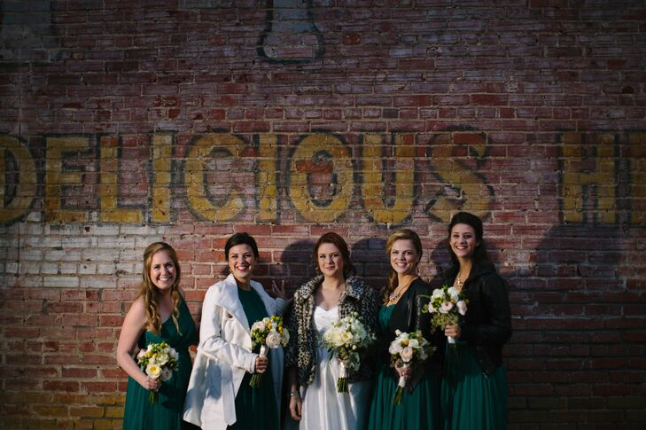 The bride's favorite color is green, so she found peacock green J.Crew gowns for her the bridesmaids.