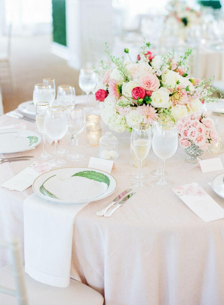 Tables were adorned with blush linens and floral arrangements of roses, dahlias and hydrangeas.