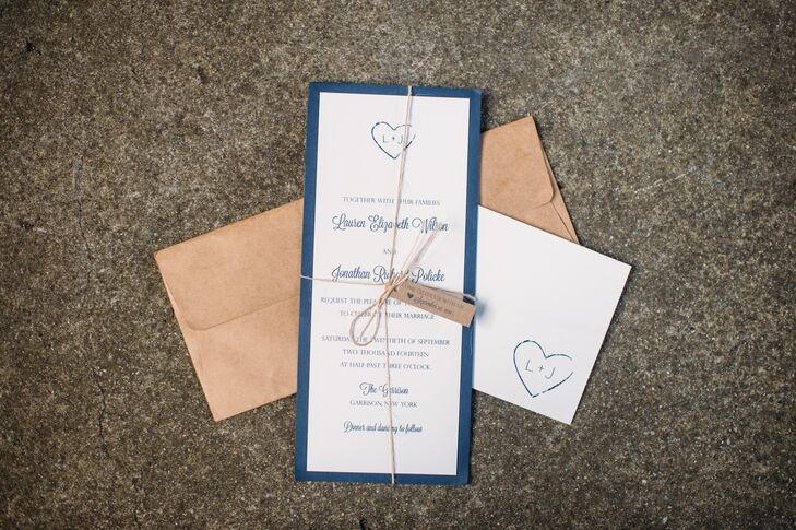 A monogram designed to resemble Lauren and Jonathan's initials carved into a tree was used throughout the day's stationery. It even made an appearance on the wedding cake.