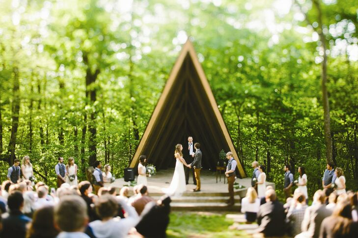 Marisa and Eric both loved the outdoors so they knew they wanted to be married in the woods. We loved the way the ceremony location was tucked up in the woods, Marisa says.