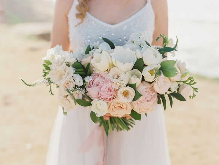 """Kasia from Plenty of Petals created the most beautiful bridal bouquet I've ever seen,"" Nicky says. ""She filled it with pastel peonies, tulips, garden roses and many other blooms, along with perfectly arranged greenery. I loved the shape she created, and when I held my bouquet up close to smell it, it felt as though I was cradling a baby."""
