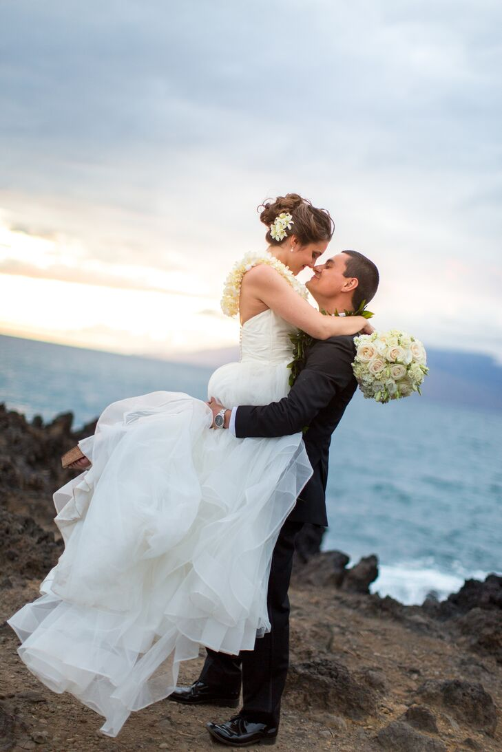 Nick picked Steph up and twirled her around near the beachfront in Maui, Hawaii, where their tropical-themed wedding took place. Steph's tulle skirt bunched at the bottom, showing the many layers that made up the elegant dress.