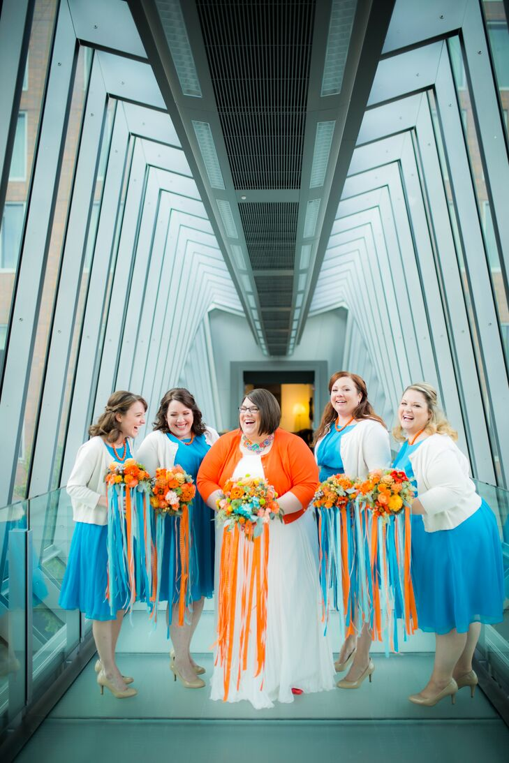"Suzette transformed an ivory bridesmaid dress into a gown. ""My dress was one of the biggest money savers of the wedding,"" she says. ""Under $200 with alterations."" She ordered the custom dress, made to her measurements, from Azazie.com. With the bride wearing orange accents, she knew she wanted her four bridesmaids in turquoise. Their look was finished with neutral cardigans, shoes and orange beaded necklaces and earrings."