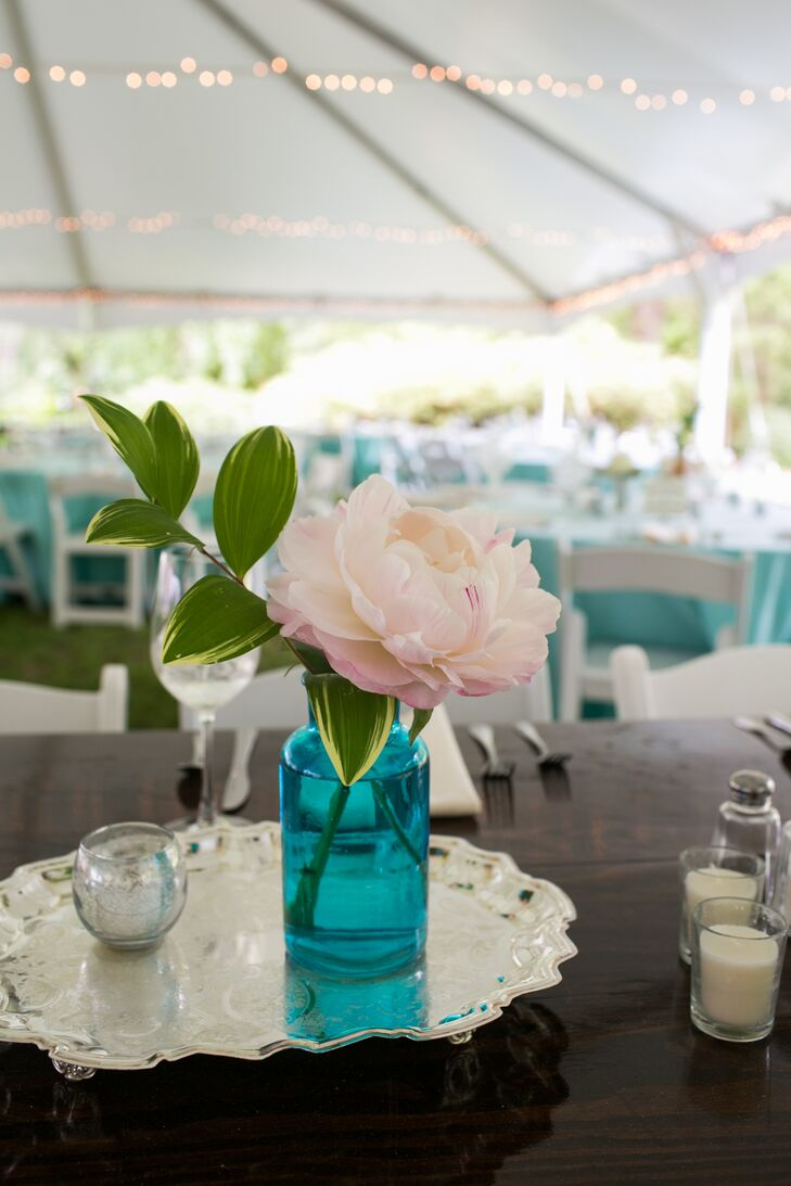 Peach blooms popped against blue vases and turquoise linens.