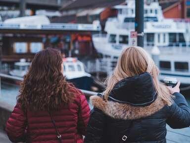 two women walking along the seattle pier