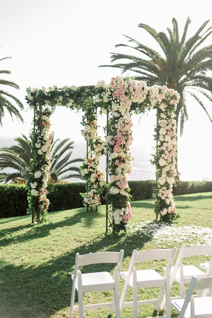Chuppah Covered in Flowers at Luxurious Bel-Air Bay Club Wedding in California