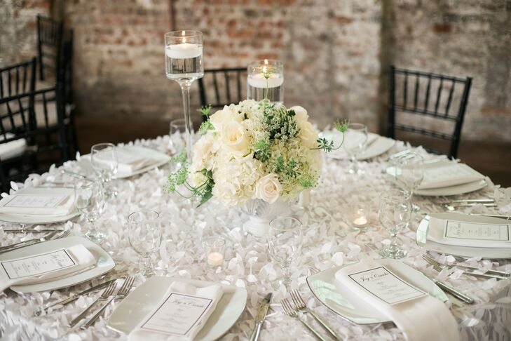 Round tables featured white petal linens, cream bouquets of garden roses (with a little greenery mixed in) and candles for an elegant, sophisticated look.