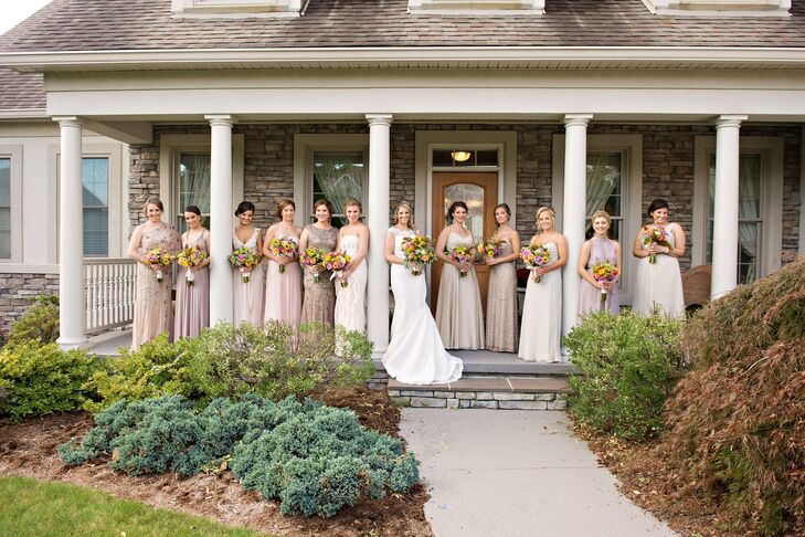 """Courtney's bridesmaids wore neutral, floor-length dresses in different styles. Courtney let them choose their own dresses. """"After being in so many weddings as a bridesmaid, I wanted to make the whole process fun and easy for my 10 bridesmaids,"""" she says."""