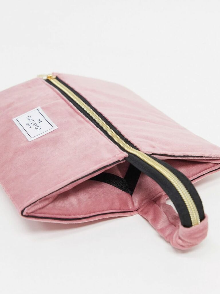flatlay pink velvet makeup bag
