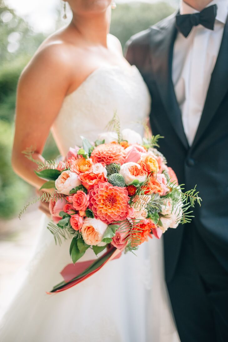 Margaret carried a beautiful pink and coral bouquet designed by Holly Heider Chapple. It included dahlias, roses, peonies, ranunculus and succulents.