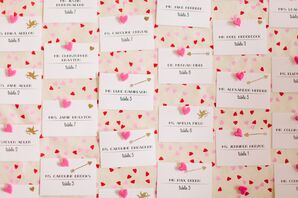 Pink and Red Heart-Themed Escort Card Display