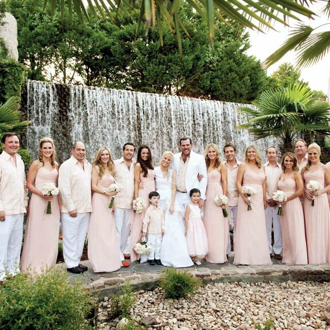 Dressing everyone in the same white and blush outfits gave the bridal party a chic, cohesive look.