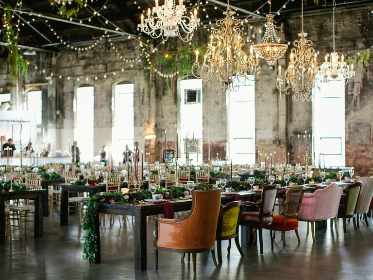 Vintage wedding venue with mismatched crystal chandeliers and velvet chairs