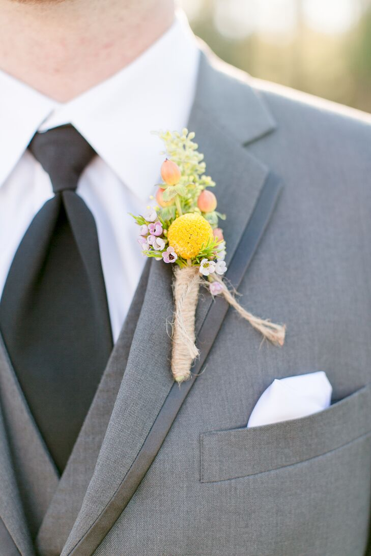 With wildflowers all over the centerpieces and bouquets, Austin picked out a boutonniere that was just as natural. The pros from Flowers by Lesley wrapped yellow craspedia, red hypericum berries and a bunch of wildflowers in twine for his custom accent.