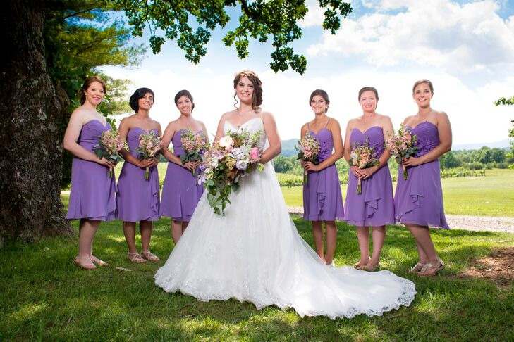 The bridesmaids wore Allure chiffon dresses with a sweetheart neckline and floral waist embellishments.